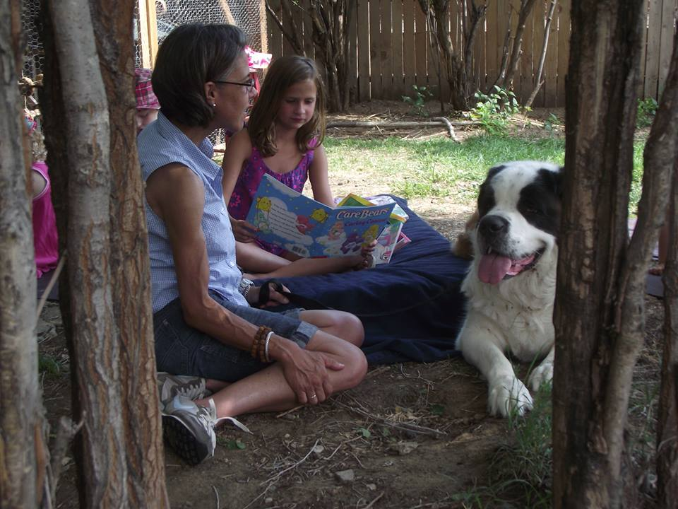 Relaxing in nature reading to Harper, the St. Bernard.