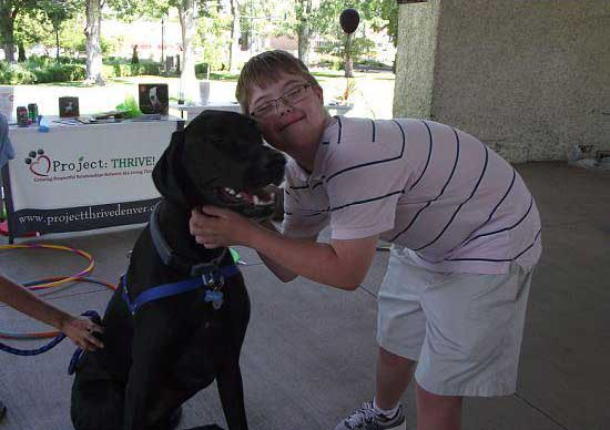 Young boy hugging Happy the Therapy Dog