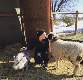 Eden kissing Poppy the lamb